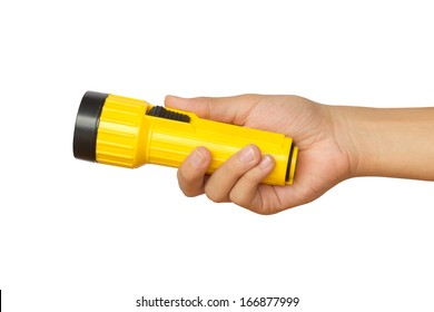 Hand holding yellow flashlight over white background - concepts of searching and direction