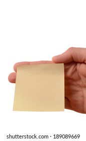 Hand holding a yellow sticky note