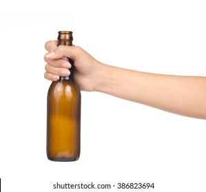 Hand holding yellow Whisky Bottle isolated on white background