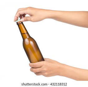 Hand holding yellow Whisky Bottle isolated on white background