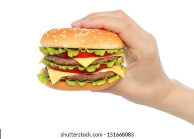 Hand holds big hamburger on white background close-up