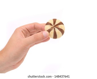 Hand holds biscuits of a chocolate cloves.