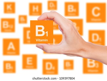 Hand holds a box of vitamin B1