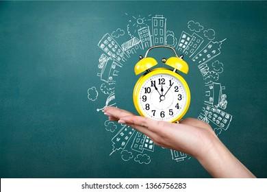 Hand holds clock time minute old alarm alert antique