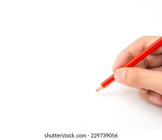 Hand holds a color pencil with white background for text.
