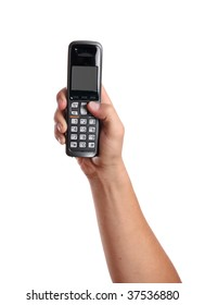 A hand holds a cordless phone isolated on white.