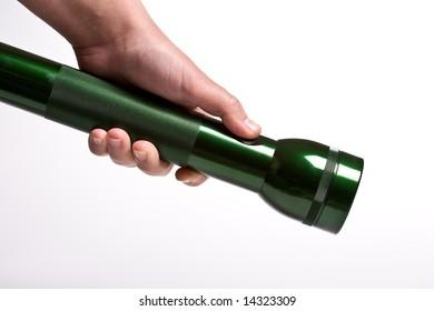 Hand holds flashlight - isolated on white