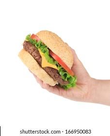 Hand holds fresh hamburger. Isolated on a white background.