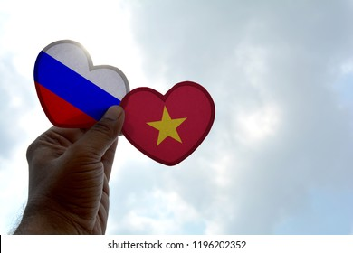 Hand holds a heart Shape Russia and Vietnam flag, love between two countries