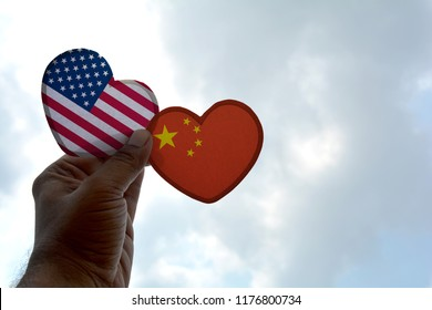 Hand holds a heart Shape USA and China flag, love between two countries