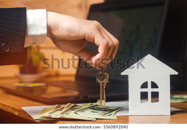 The hand holds the keys to the house. concept of real estate. sale or rental of housing, apartment rental. realtor