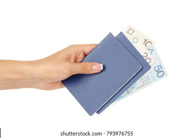 Hand holds passports with Polish zloty, isolated on white