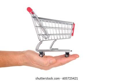Hand holds shopping cart isolated on white background