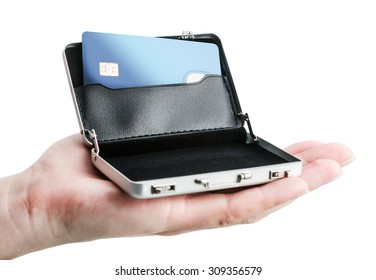 hand holds a small aluminum case with a credit card. Focus on credit card
