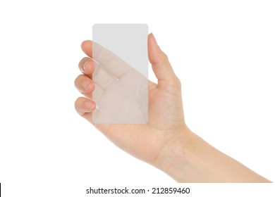 Hand holds transparent card on white background