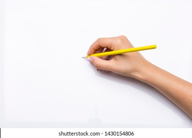 hand holds yellow pencil in blank white background
