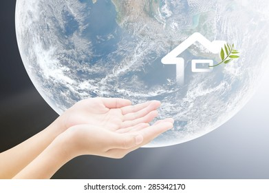 Hand and home on earth background , concept design , Elements of image are furnished by NASA