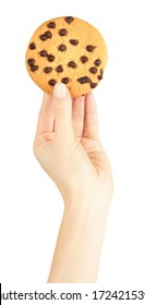 Hand with homemade cookie and chocolate drops. Isolated on white background.