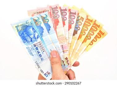 Hand with HongKong Dollars