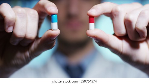 hand of a hospital medical expert shows the pill to be taken to his patient. concept of generical pills