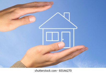 Hand house on blue sky