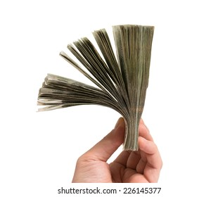 hand with huge amount of money, isolated on white