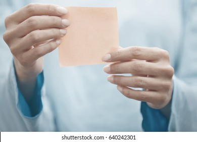 Hand of human holding adhesive note with copy space