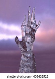 Hand of ice reaching for the dark sky. Symbol for giving the cold hand, frozen in time, natural ice sculptures, formations etc.