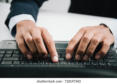 The hand image at keyboard of the notebook, he in a hurry speed to work on a notebook computer of he.