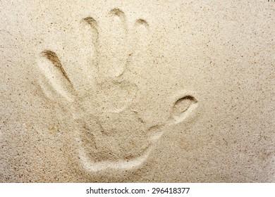 Hand imprint on sand