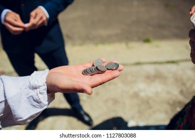 Hand injured bloody finger holds banknote grey background. Dirty money concept. Bloody currency. Money covered with traces of crime. Handover criminal profit. Dollar marked by murder.