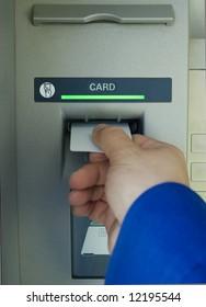 hand inserting blank card into cash machine