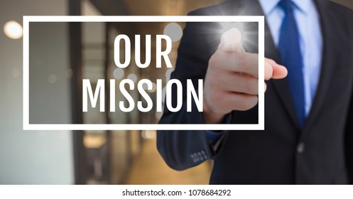 Hand interacting with our mission business text against blurred background