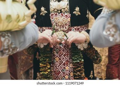 Hand of Javanase Woman doing Javanese Traditional Wedding Ceremony Balang Gantal