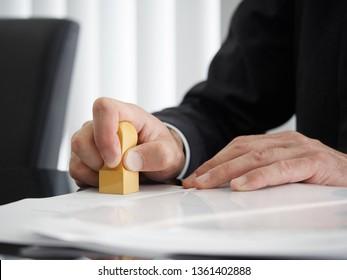 Hand of a judicial scrivener who puts a mark