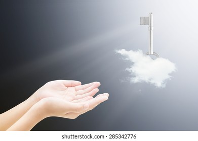 Hand and key on cloud , success concept