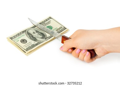 Hand with knife cutting money isolated on white background