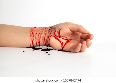 Hand and knife stained with blood