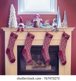 Hand knit Christmas stocking hung on the mantle.