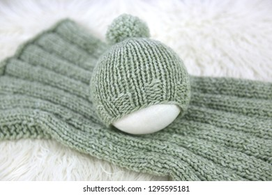 Hand knit pom pom hat and blanket