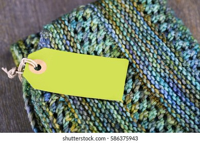 Hand knitted scarf with label and copy space