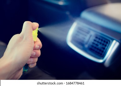 Hand of lady that spraying alcohol,disinfectant on  Air conditioner in her car,prevent infection of Covid19,Coronavirus,nCoV,contamination of germ,bacteria,wipe clean surfaces that are frequently touc