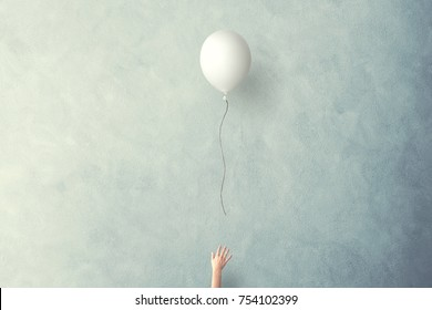 hand let white balloon fly free