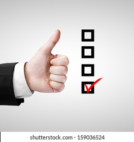 hand like and checklist on a gray background