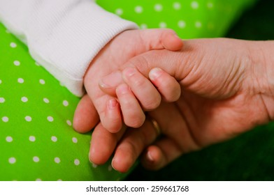 hand of a little baby in mother's hand