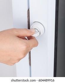 hand locking door knob of the glass door