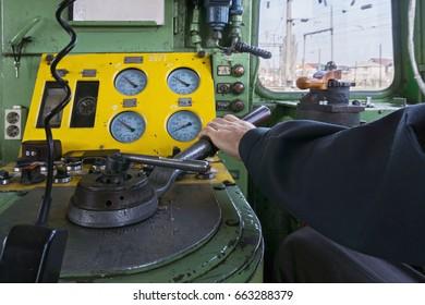 The hand of locomotive engineer on handle. Horizontal shot