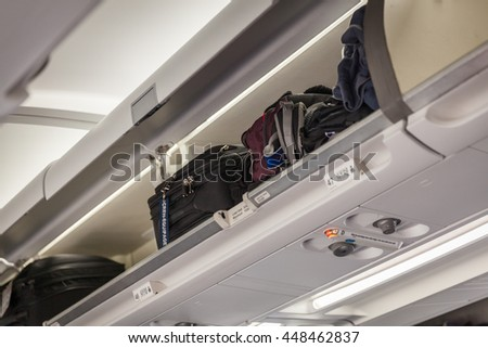 Hand luggage into the compartment on the plane