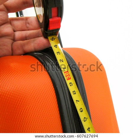 Hand luggage and ruler