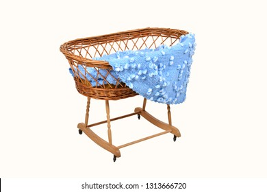 hand made baby wicker cot with blue doily